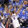Oklahoma City\'s Russell Westbrook (0) looses the ball past Miami\'s Dwyane Wade (3) during Game 2 of the NBA Finals between the Oklahoma City Thunder and the Miami Heat at Chesapeake Energy Arena in Oklahoma City, Thursday, June 14, 2012. Photo by Chris Landsberger, The Oklahoman