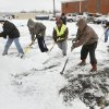 Church members work together to clear snow from the parking lot at the Ridgecrest United Methodist Church in Oklahoma City, OK, Saturday, Jan. 30, 2010. By Paul Hellstern, The Oklahoman