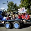 DECA club members ride in the Edmond Memorial High School homecoming parade. PHOTO BY BRYAN TERRY, THE OKLAHOMAN. Bryan Terry - THE OKLAHOMAN