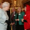 Photo - Britain's Queen Elizabeth II meets Malala Yousafzai during a reception for youth, education and the Commonwealth at Buckingham Palace, London, Friday Oct. 18, 2013. The Pakistani teenager, an advocate for education for girls, survived a Taliban assassination attempt last year on her way home from school. (AP Photo/Yui Mok, Pool)