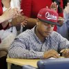 Heritage Hall\'s Sterling Shepard signs to play football for the University of Oklahoma as family members applaud during the National Signing Day ceremony at Heritage Hall in Oklahoma City, Wednesday, Feb. 1, 2012. Photo by Nate Billings, The Oklahoman