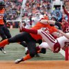 Oklahoma\'s Michael Hunnicutt (18) scores a touchdown as he is hit by Oklahoma State\'s Caleb Lavey (45) on a fake field goal attempt during the Bedlam college football game between the Oklahoma State University Cowboys (OSU) and the University of Oklahoma Sooners (OU) at Boone Pickens Stadium in Stillwater, Okla., Saturday, Dec. 7, 2013. Photo by Chris Landsberger, The Oklahoman
