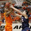 Oklahoma State\'s Le\'Bryan Nash (2) fights for the ball with Texas-San Antonio\'s Jeromie Hill (12) during an NCAA college basketball game between the Oklahoma State University Cowboys (OSU) and the University of Texas-San Antonio Roadrunners at Gallagher-Iba Arena in Stillwater, Okla., Wednesday, Nov. 16, 2011. Photo by Bryan Terry, The Oklahoman