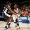 OU / UNIVERSITY OF OKLAHOMA / NCAA TOURNAMENT / SWEET SIXTEEN / SWEET 16: OU\'s Danielle Robinson drives around Pittsburgh\'s Xenia Stewart during the NCAA women\'s college basketball tournament game between Oklahoma and Pittsburgh at the Ford Center in Oklahoma City, Sunday, March 29, 2009. PHOTO BY BRYAN TERRY, THE OKLAHOMAN ORG XMIT: KOD