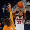 Photo - Mississippi forward Tia Faleru (32) goes up for a shot past Tennessee guard Meighan Simmons (10) during the first half of an NCAA college basketball game in Oxford, Miss., Thursday, Feb. 6, 2014. (AP Photo/Thomas Graning)