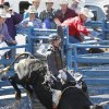 Justin Watts, from Brandon, MS, in the Bull Riding at the International Finals Youth Rodeo in Shawnee, Friday, July 11, 2014. Photo by David McDaniel, The Oklahoman