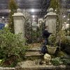 This feb. 28, 2013 photo shows Steve Eshelman with Stoney Bank Nurseries working on an installation in preparation for the annual Philadelphia Flower Show at the Pennsylvania Convention Center in Philadelphia. More than 270,000 people are expected to converge on the Pennsylvania Convention Center for the event, which runs through March 10. Billed as the world\'s largest indoor flower show, it\'s also one of the oldest, dating back to 1829. (AP Photo/Matt Rourke)