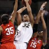 Lindsay Wisdom-Hylton (32) shoots between Brittany Ray (35) and Kia Vaughn (15) in the first half of the NCAA women\'s basketball tournament game between Rutgers and Purdue at the Ford Center in Oklahoma City, Okla. on Sunday, March 29, 2009. PHOTO BY STEVE SISNEY, THE OKLAHOMAN