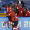 Photo - Lara Stalder of Switzerland is greeted at the bench after scoring against Russia during the 2014 Winter Olympics women's ice hockey quarterfinal game at Shayba Arena, Saturday, Feb. 15, 2014, in Sochi, Russia. Switzerland defeated Russia 2-0. (AP Photo/Matt Slocum)