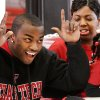 Two Carl Albert High School football players signed letters of intent with colleges during a signing ceremony in the school\'s fieldhouse, Wednesday morning, Feb, 3, 2010. Tre Porter gives the Texas Tech Red Raiders\'