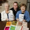 Delores Walker, Rev. Wayne Sissons, and Jo Anne Shingleton holding copies of the new church cookbook published by the Exchange Avenue Baptist Church in Oklahoma City Wednesday, Nov. 2, 2011. The first cookbook by the church was published in 1971 and in the foreground are copies representing forty years. Photo by Paul B. Southerland, The Oklahoman