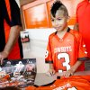 Dominik Villanueva, 9 of Clinton, gets a jersey autographed by Oklahoma State football players August 3, 2013 at Gallagher-Iba Arena for fan appreciation day. Dominik said meeting his favorite player Clint Chelf was