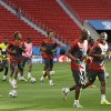 Photo - Members of the Cameroon national soccer team jog during an official training session the day before the group A World Cup soccer match between Brazil and Cameroon at the Estadio Nacional in Brasilia, Sunday, June 22, 2014. Cameroon began the tournament with a 1-0 loss to Mexico and a 4-0 defeat to Croatia and it will now face the hosts Brazil. (AP Photo/Andre Penner)