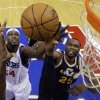 Philadelphia 76ers\' Kwame Brown, left, and Utah Jazz\'s Al Jefferson battle for a rebound in the first half of an NBA basketball game on Friday, Nov. 16, 2012, in Philadelphia. (AP Photo/Matt Slocum)
