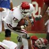 Trey Metoyer (17) is stopped by Tom Wort (21) during the University of Oklahoma (OU) football team\'s annual Red and White Game at Gaylord Family/Oklahoma Memorial Stadium on Saturday, April 14, 2012, in Norman, Okla. Photo by Steve Sisney, The Oklahoman