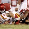 OU\'s Jonathan Miller, left, and Frank Alexander bring down Iowa State\'s Ben Jerome Tiller during the second half of the college football game between the University of Oklahoma Sooners (OU) and the Iowa State Cyclones (ISU) at the Gaylord Family-Oklahoma Memorial Stadium on Saturday, Oct. 16, 2010, in Norman, Okla. Photo by Bryan Terry, The Oklahoman