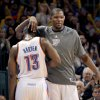 CELEBRATION: Oklahoma City Thunder\'s Kevin Durant (35) celebrates with Oklahoma City Thunder\'s James Harden (13) during the NBA basketball game between the Oklahoma City Thunder and the San Antonio Spurs at the Chesapeake Energy Arena in Oklahoma City, Sunday, Jan. 8, 2012. Photo by Sarah Phipps, The Oklahoman