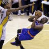 Photo - New York Knicks guard Raymond Felton, right, shoots under Indiana Pacers forward Paul George during the third quarter of Game 6 of the Eastern Conference semifinal NBA basketball playoff series in Indianapolis, Saturday, May 18, 2013. (AP Photo/Michael Conroy)