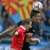 Photo - Paderborn's Stefan Kutschke , right, challenges for the ball with Mainz' Niko Bungert during the German Bundesliga soccer match between SC Paderborn and Mainz 05 in Paderborn, Germany, Sunday Aug. 24, 2014.  (AP Photo/dpa,Oliver Krato)
