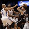 Photo - Brooklyn Nets' Deron Williams, right, is pressured by Oklahoma City Thunder's Derek Fisher, left, and Serge Ibaka during the first half of an NBA basketball game Friday, Jan. 31, 2014, in New York. (AP Photo/Seth Wenig)