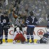 Photo - The referee calls a penalty shot on the Winnipeg Jets after Adam Pardy (2) hauled down Columbus Blue Jackets' Boone Jenner (38) during second period of an NHL hockey game in Winnipeg, Manitoba, on Saturday, Jan. 11, 2014. (AP Photo/The Canadian Press, John Woods)