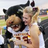 Putnam City North cheerleader Korbi Wood laughs as the PC North Panther gives her an oversized fake engagment ring during a high school football game between Mustang and Putnam City North in Mustang, Okla., Friday, Sept. 7, 2012. Photo by Nate Billings, The Oklahoman