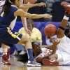 Oklahoma\'s Sharane Campbell (24) tries to pass the ball under West Virginia\'s Christal Caldwell (1) during the Big 12 tournament women\'s college basketball game between the University of Oklahoma and West Virginia at American Airlines Arena in Dallas, Saturday, March 9, 2012. Photo by Bryan Terry, The Oklahoman