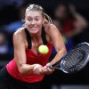 Russia\'s Maria Sharapova hits a backhand against Australian Samantha Stosur during their quarterfinal match at the Porsche tennis Grand Prix in Stuttgart, Germany, Friday, April 27, 2012. (AP Photo/Michael Probst) ORG XMIT: PSTU122