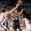 San Antonio\'s Manu Ginobili (20) passes between Oklahoma City\'s Nick Collison (4) and Thabo Sefolosha (2) during Game 6 of the Western Conference Finals between the Oklahoma City Thunder and the San Antonio Spurs in the NBA playoffs at the Chesapeake Energy Arena in Oklahoma City, Wednesday, June 6, 2012. Photo by Bryan Terry, The Oklahoman