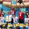 Sonya Thomas, center, wins the Nathan\'s Famous Fourth of July International Hot Dog Eating contest alongside Juliet Lee, left, and Michelle Lesco, right, at Coney Island, Thursday, July 4, 2013, in the Brooklyn borough of New York. (AP Photo/John Minchillo)
