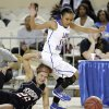 Verdigris\' Baileigh O\'Dell (25) and Millwood\'s Teanna Reid (10) chase down a loose ball during the 3A girls quarterfinals game between Millwood High School and Verdigris High School at the State Fair Arena on Thursday, March 7, 2013, in Oklahoma City, Okla. Photo by Chris Landsberger, The Oklahoman