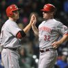 Photo -   Cincinnati Reds' Joey Votto left, celebrates with Jay Bruce after both scored on a three-run double by Ryan Hanigan in the sixth inning during a baseball game against the Chicago Cubs in Chicago, Tuesday, Sept. 18, 2012. (AP Photo/Paul Beaty)