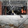 In this Wednesday, Dec. 12, 2012 photo released by the Syrian official news agency SANA, damages after an explosion hit the main gate of the Syrian Interior Ministry in Damascus, Syria. Three bombs collapsed walls in the Syrian Interior Ministry building Wednesday in Damascus, killing several, as rebels fighting to overthrow President Bashar Assad edged closer to the capital, the symbol of his power. (AP Photo/SANA)