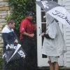 Photo - Lee Westwood, center, heads into into a building to avoid rain during the final round of the BMW Championship golf tournament at Conway Farms Golf Club in Lake Forest, Ill., Sunday Sept. 15, 2013. (AP Photo/Matt Marton)