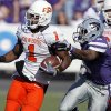 Oklahoma State\'s Joseph Randle (1) gets past Kansas State\'s Stephen Harrison (8) during the first half of the college football game between the Oklahoma State University Cowboys (OSU) and the Kansas State University Wildcats (KSU) on Saturday, Oct. 30, 2010, in Manhattan, Kan. Photo by Chris Landsberger, The Oklahoman