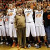 Boone Pickens, middle, sings the alma mater with the OSU Cowboys including, from left, Christien Sager (15), Marcus Smart (33), Mason Cox (30), Le\'Bryan Nash (2) and Alex Budke (23) after a men\'s college basketball game between Oklahoma State University and the University of Texas at Gallagher-Iba Arena in Stillwater, Okla., Saturday, March 2, 2013. OSU won, 78-65. Photo by Nate Billings, The Oklahoman