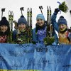 Photo - From left, Ukraine's relay team Vita Semerenko, Juliya Dzhyma, Olena Pidhrushna and Valj Semerenko pose with an Ukraine's flag, after winning the gold medal in the women's biathlon 4x6k relay at the 2014 Winter Olympics, Friday, Feb. 21, 2014, in Krasnaya Polyana, Russia. (AP Photo/Lee Jin-man)