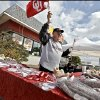 FANS / UNIVERSITY OF OKLAHOMA / COLLEGE FOOTBALL: A vendor waves an OU car flag as he tries to make a sale during the Bevo Bash on Friday, Oct. 12, 2012, in Marietta, Okla. Photo by Chris Landsberger, The Oklahoman
