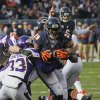 Photo -   Chicago Bears running back Michael Bush (29) rushes for a touchdown against Minnesota Vikings safety Jamarca Sanford (33) in the first half of an NFL football game in Chicago, Sunday, Nov. 25, 2012. (AP Photo/Charles Rex Arbogast)