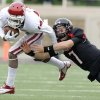 Photo -   Texas Tech's Seth Doege tries to tackle Aaron Colvin after Colvin intercepted Doege's pass during an NCAA college football game in Lubbock, Texas, Saturday, Oct. 6, 2012. (AP Photo/Lubbock Avalanche-Journal, Scott MacWatters) LOCAL TV OUT