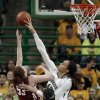 Baylor\'s Brittney Griner (42) blocks the shot of Oklahoma\'s Joanna McFarland (53) during the second half of an NCAA college basketball game Saturday, Jan. 26, 2013, in Waco Texas. It was Griners\' 665th career blocked shot, surpassing the NCAA women\'s record set by Louella Tomlinson for St. Mary\'s in California from 2007-11. Baylor won 82-65. (AP Photo/LM Otero) ORG XMIT: TXMO105
