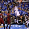 Oklahoma City\'s Serge Ibaka (9) dunks the ball beside Miami\'s LeBron James (6) and Udonis Haslem (40) as Kendrick Perkins watches during Game 1 of the NBA Finals between the Oklahoma City Thunder and the Miami Heat at Chesapeake Energy Arena in Oklahoma City, Tuesday, June 12, 2012. Photo by Sarah Phipps, The Oklahoman