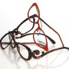 Eyelgasses have gone from nerd necessity to fashion accessory. Shown, from left are pairs from Fiction, l.a. Eyeworks, and Prada. (Kirk McKoy/Los Angeles Times/MCT)