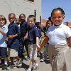 White students hold hands with black students as they march around their school. About 400 Students from Martin Luther King Jr. Elementary School, 1201 NE 48, commemorated the 50th anniversary of Martin Luther King, Jr\'s