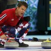 Photo - Norway's skip Thomas Ulsrud shouts instructions to his sweepers during a tiebreaker game against Britain in men's curling competition against at the 2014 Winter Olympics, Tuesday, Feb. 18, 2014, in Sochi, Russia. (AP Photo/Robert F. Bukaty)