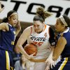 Oklahoma State\'s Lindsey Keller (25) fights for control of the ball between West Virginia\'s Christal Caldwell (1) and Ayana Dunning (33) during a women\'s college basketball game between Oklahoma State and West Virginia at Gallagher-Iba Arena in Stillwater, Okla., Tuesday, Jan. 29, 2013. Photo by Bryan Terry, The Oklahoman