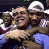 Daryan Selvy hugs coach Kelvin Sampson after the OU Sooners beat Texas 54 to 45 in the BIG 12 tournament championship college basketball game in Kansas City. Staff photo by Bryan Terry