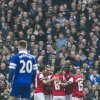 Photo - Arsenal's players celebrate after scoring against Everton, during their FA Cup quarterfinal soccer match, at Emirates Stadium, in London, Saturday, March 8, 2014. (AP Photo/Bogdan Maran)
