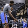 Oklahoma City\'s Hasheem Thabeet (34) greets fans Andrew Ismailer, right, and Sam Ismailer of San Francisco before Game 5 of the Western Conference Finals in the NBA playoffs between the Oklahoma City Thunder and the San Antonio Spurs at the AT&T Center in San Antonio, Thursday, May 29, 2014. Photo by Sarah Phipps