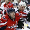 Photo - Washington Capitals defenseman Jack Hillen (38) and Los Angeles Kings left wing Kyle Clifford (13) keep their eye on the puck in the first period of an NHL hockey game, Tuesday, March 25, 2014, in Washington. (AP Photo/Alex Brandon)